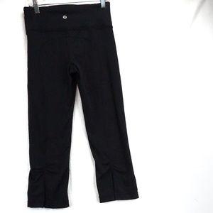 Lululemon black Capri leggings with slit size 2